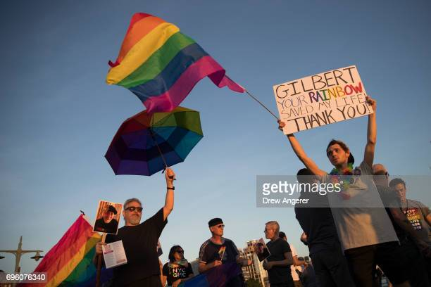 Participants march during a Flag Day 'Raise the Rainbow' rally June 14 2017 in New York City The event honored LGBT rainbow flag creator Gilbert...