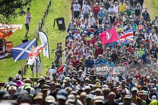 Participants march during the 100th edition 100th edition of the annual Four Days March of Nijmegen on July 21 2016 The 'Nijmeegse Vierdaagse' is an...