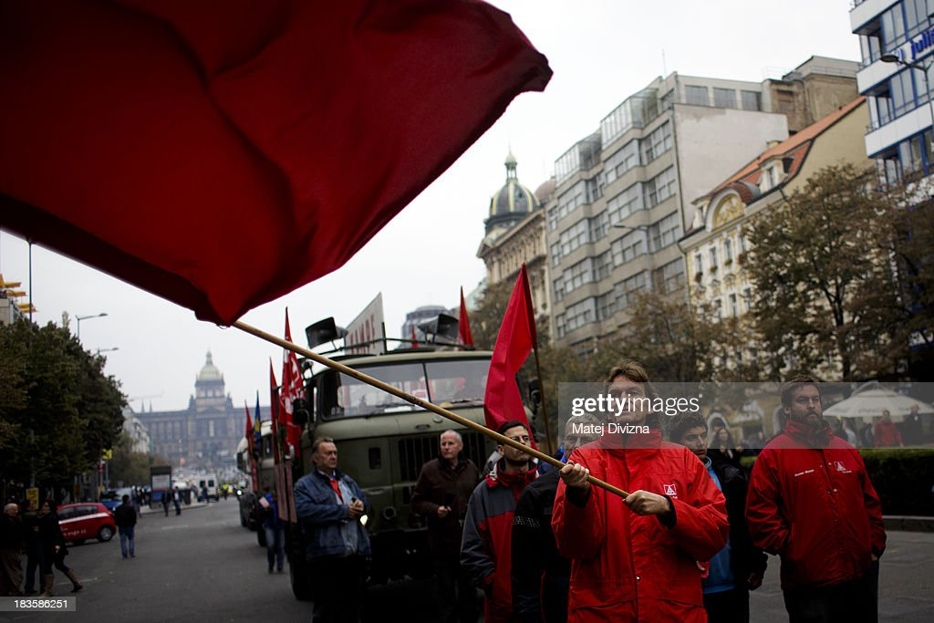 Participants march during the 'Klassenkampf statt Weltkrieg' (Class Struggle Instead of World War), a campaign supported by Deutsche Kommunistische Partei (DKP), at the Wenceslas square on October 7, 2013 in Prague, Czech Republic. The meeting took place to mark the 75th Anniversary of The Munich Pact.