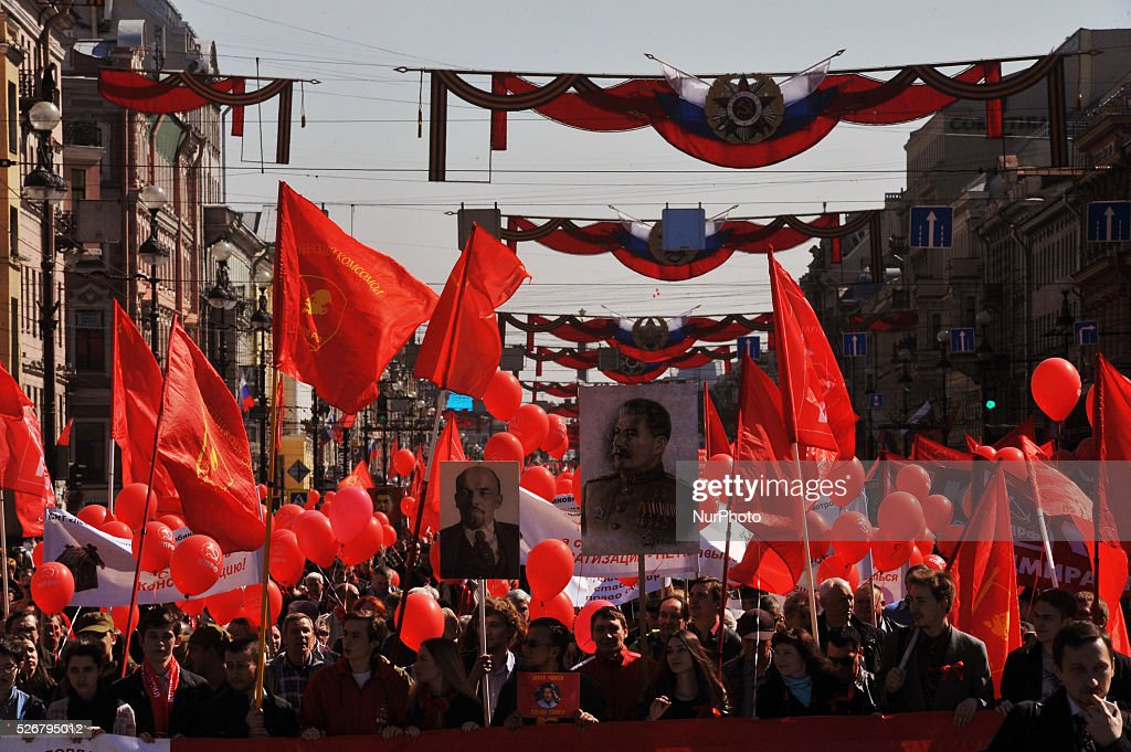 Participants march during the May Day demonstration in St. Petersburg, Russia, on May, 1, 2016. Labor Day or May Day is observed all over the world on the first day of the May to celebrate the economic and social achievements of workers and fight for laborers rights.