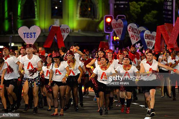 Participants march during the Sydney's annual gay and lesbian Mardi Gras night parade on March 1 2013 Some 10000 revellers on 144 individual floats...