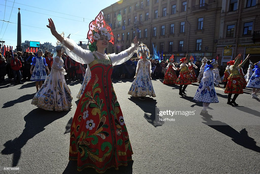 Participants march in Russian national suits perform before the May Day demonstration in St. Petersburg, Russia, on May, 1, 2016. Labor Day or May Day is observed all over the world on the first day of the May to celebrate the economic and social achievements of workers and fight for laborers rights.
