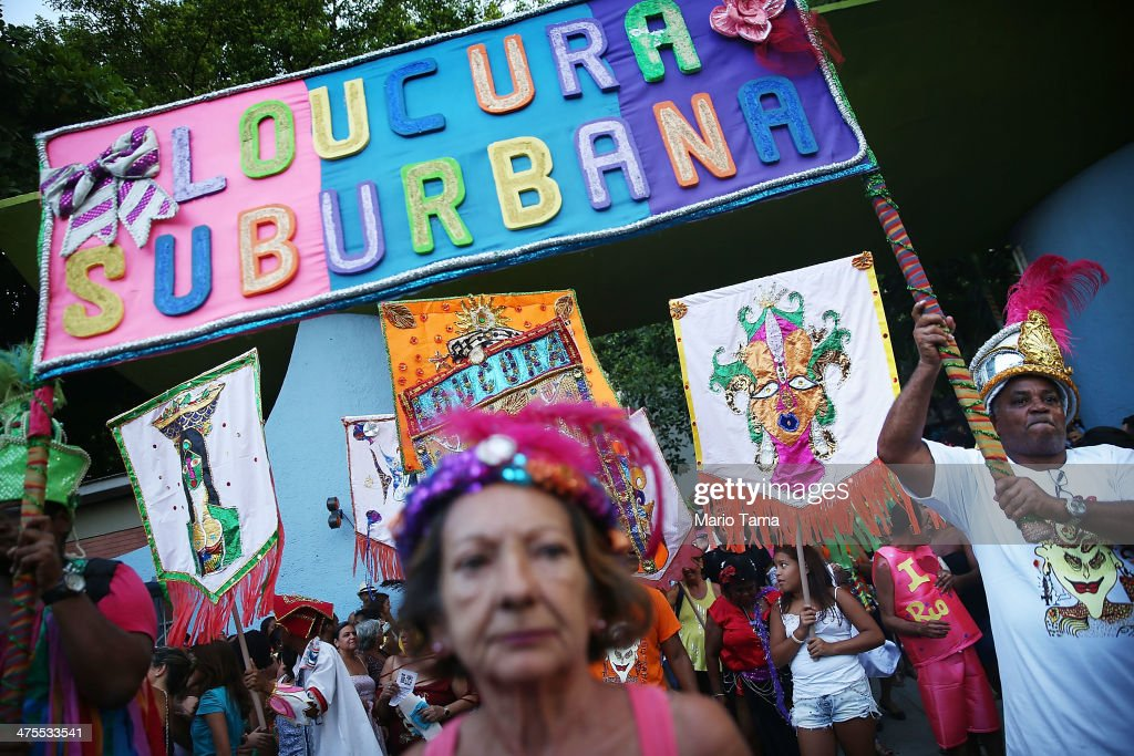 Resultado de imagem para Participants in the 'Loucura Suburbana' (Suburban Madness) Carnival street parade organised by the Nise da Silveira mental health institution,
