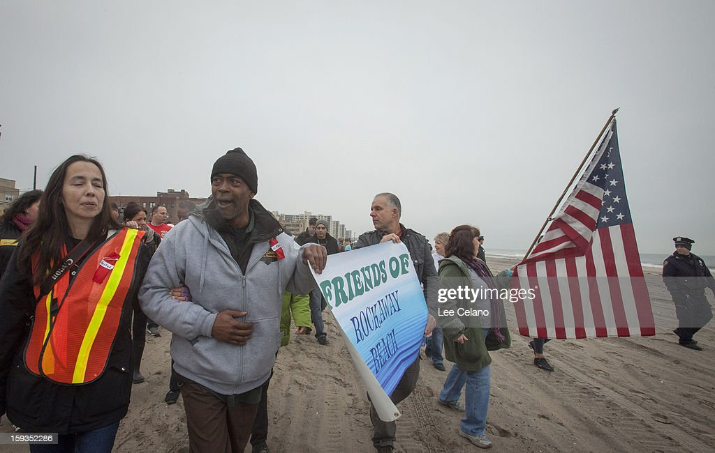 Participants march in the ''Walk a Mile in Our Shoes'' for Hurricane Sandy victims on January 12, 2013 in the Rockaway neighborhood, of the Queens borough of New York City. The event was organized to bring attention to the faltering recovery in the area that was badly affected by Hurricane Sandy, and to urge Congress to pass an aid bill scheduled for January 15.