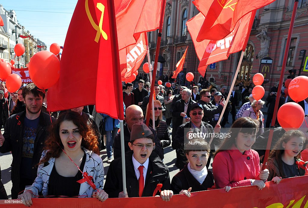 Participants march shout a slogan during the May Day demonstration in St. Petersburg, Russia, on May, 1, 2016. Labor Day or May Day is observed all over the world on the first day of the May to celebrate the economic and social achievements of workers and fight for laborers rights.