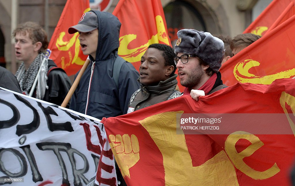 Participants march with banners and flags during the traditional May Day rally in Strasbourg, eastern France, on May 1, 2016. / AFP / PATRICK