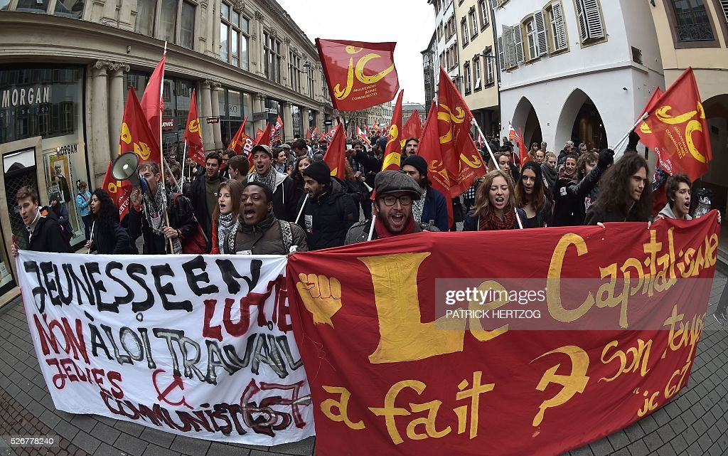 Participants march with banners during the traditional May Day rally in Strasbourg, eastern France, on May 1, 2016. / AFP / PATRICK