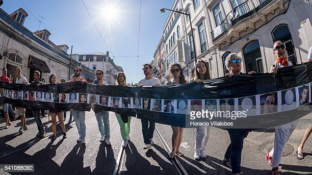Participants march with the photos of Orlando mass shooting victims during the 17th LGBT parade on June 18 2016 in Lisbon Portugal Thousands gathered...