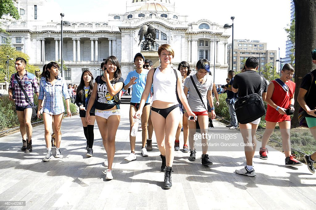 Participants not wearing pants pose outside a subway station while taking part in the annual No Pants Subway Ride on January 12, 2014 in Mexico City, Mexico.