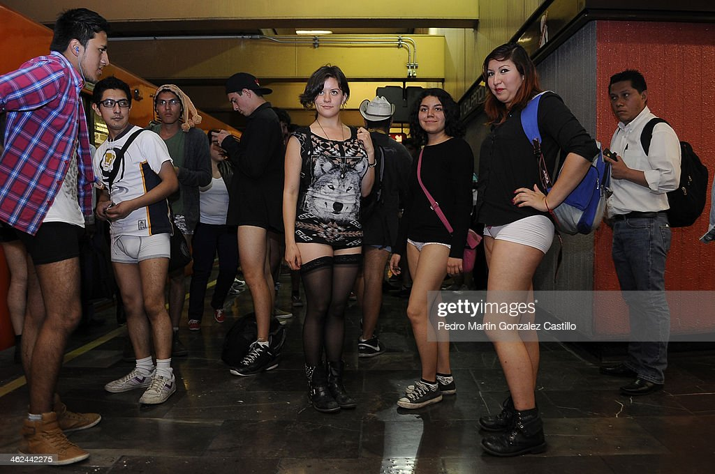 Participants not wearing pants stand in front of a subway train while taking part in the annual No Pants Subway Ride on January 12, 2014 in Mexico City, Mexico.