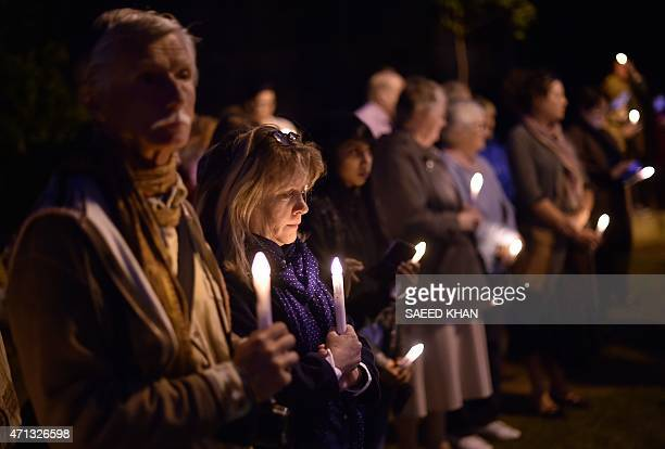 Participants observe a minute's silence for the Nepal earthquake victims during a candle light vigil on Sydney Harbour foreshore on April 27 which...