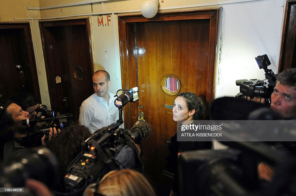 Participants of a demonstration called by the European Union of Jewish Students try to open the door of Laszlo Csatary's hideaway building, only a few kilometers from his home in Budapest on July 16, 2012, after a Hungarian prosecutor said that investigating an aged Nazi war criminal found alive and well in Budapest was problematic because the events took place so long ago and in a different country. A probe into Laszlo Csatary, 97, began in September after information was received from the Nazi-hunting Simon Wiesenthal Center, which ranks him number one on their wanted list, the public prosecutors' office said.