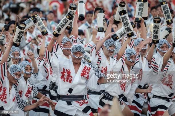 Participants of a 'load team' perform during the Awa Odori festival in Tokushima on August 12 2017 The fourday dance festival attracts more than 12...