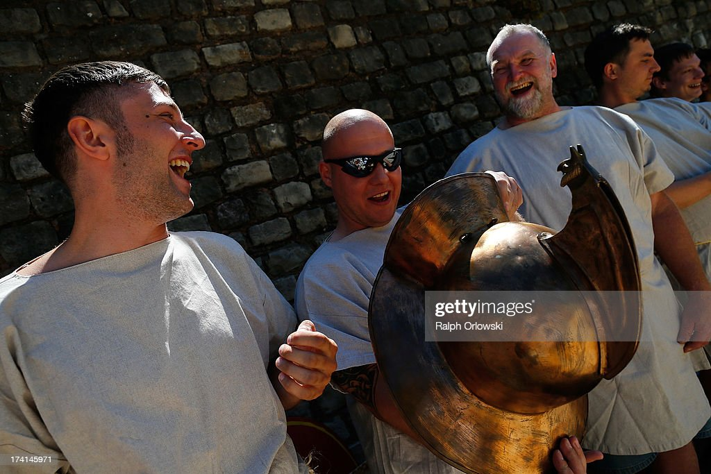 Participants of a one-day course at the Gladiator School in the Roman-era amphitheater examine a helmet on July 20, 2013 in Trier, Germany. The Gladiator School, launched by Krueger in 2011, seeks to teach not only the fighting skills of the gladiators of ancient Rome, but also the philosophy behind the gladiator ethos. The school offers a variety of classes, including one and three-day courses.