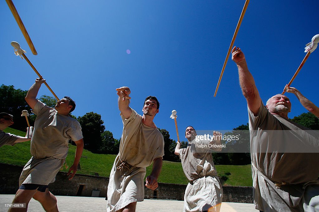 Participants of a one-day course at the Gladiator School in the Roman-era amphitheater throw wooden lances on July 20, 2013 in Trier, Germany. The Gladiator School, launched by Krueger in 2011, seeks to teach not only the fighting skills of the gladiators of ancient Rome, but also the philosophy behind the gladiator ethos. The school offers a variety of classes, including one and three-day courses.