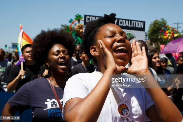 Participants of a peace rally march through the streets marking the 25th anniversary of the LA riots on April 29 2017 in Los Angeles California The...
