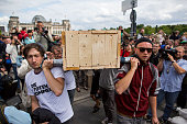 Participants of a rally carry a symbolic coffin in front of the German Parliament Building on June 21 2015 in Berlin Germany A German artist group...