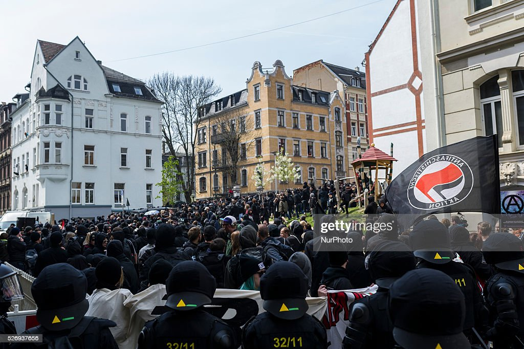 Participants of a right-wing extremist demonstration carrying placards promoting the so-called 'Third Way' march through Plauen, Germany, 01 May 2016. Parties, trade unions and churches had called for counter-protests.