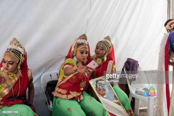 Participants of Diwali celebrations take selfie at backstage during the Diwali Celebrations on October 18 2017 at Brickfield In Kuala Lumpur Malaysia...