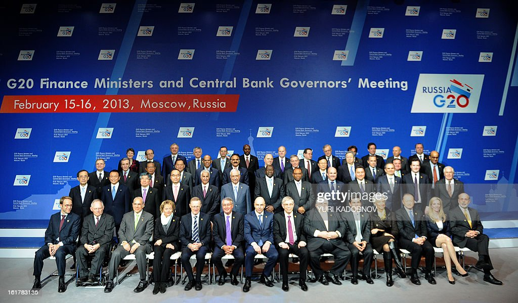 Participants of G20 states finance ministers and central bank governors meeting pose for family picture in Moscow, on February 16, 2013. The ministers and central bank governors gathered today in Moscow for their first meeting in the Russian capital aimed at reassuring markets that the world's economic powers would not slug it out in 'currency wars' to boost national growth. AFP HOTO/YURI KADOBNOV