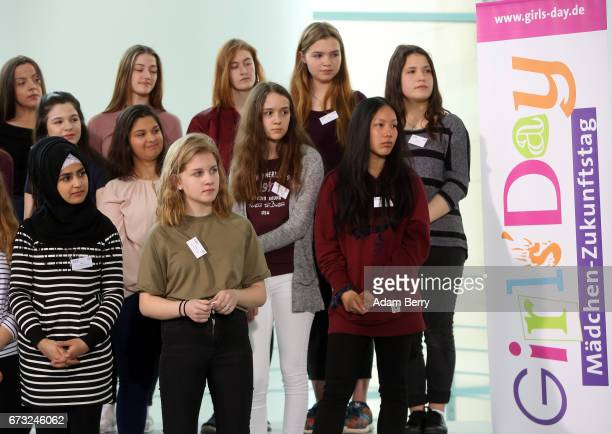 Participants of Girls' Day listen to German Chancellor Angela Merkel speak on April 26 2017 in Berlin Germany The event is meant to encourage young...