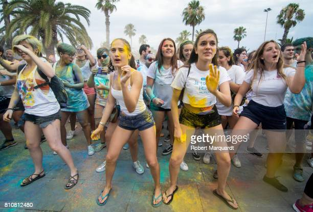 Participants of Holi Pride are seen throwing different colored pigments into the air during Gay Pride Week held at the Port of Barcelona on July 8...