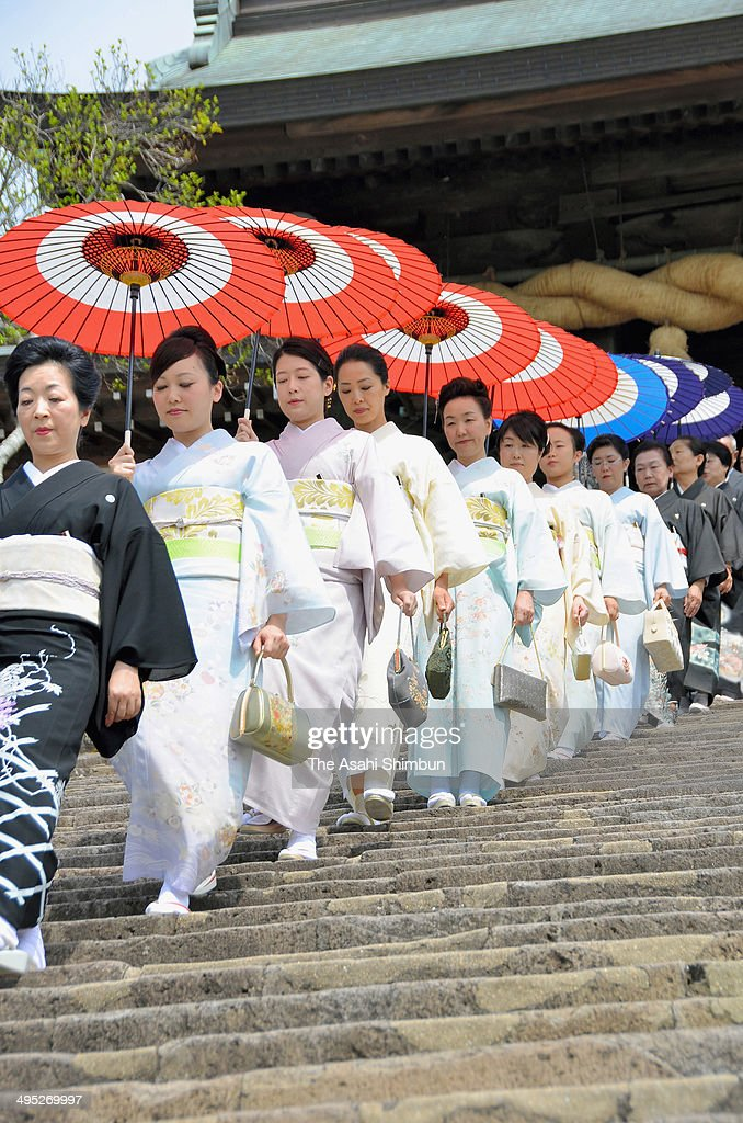 Participants of 'Koyairi', beginning of dance practice for Nagasaki Kunchi festival walk down steps after the 'Kiyoharai' purification at Suwa Shrine on June 1, 2014 in Nagasaki, Japan. The festival will be held October 7 to 9.