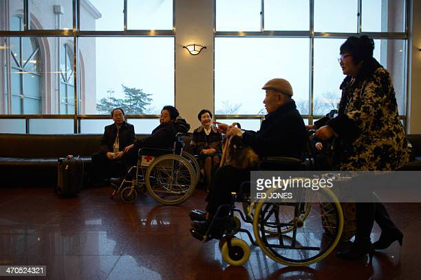 Participants of North and South family reunions pass through the lobby of their hotel as they prepare to depart for the North Korean border in the...