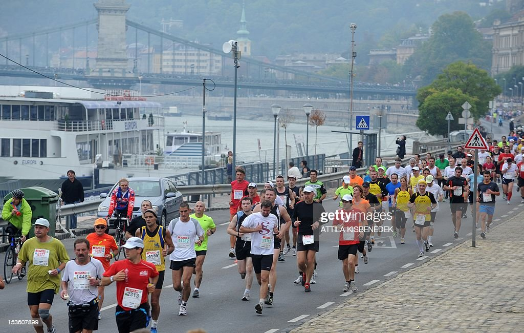 Participants of the 27 annual SPAR Budapest Marathon run next to the Danube River in Budapest, Hungary on October 7, 2012. AFP PHOTO / ATTILA KISBENEDEK
