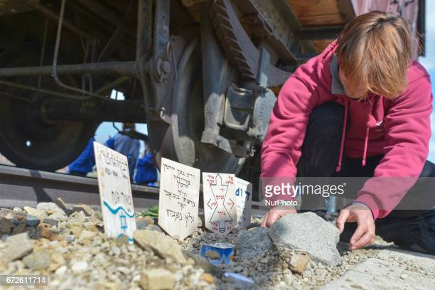 A participants of the annual March of the Living places memory plaques on the rails in the former German Nazi Death Camp AuschwitzBirkenau Jewish...