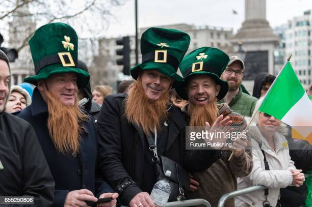 Participants of the annual St Patricks Day parade celebrate Irelands national holiday and the patron saint of Ireland on March 19 2017 in London...