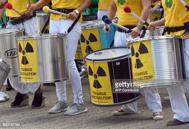 CORRECTION Participants of the antinuclear 'Chain Reaction' demonstration beat the drums to protest against the operation of Belgium's Tihange 2 and...