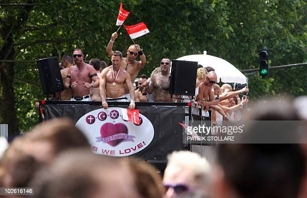 Participants of the Christopher Street Day gay pride parade celebrate in Cologne western Germany on July 4 2010 Thousands of gays and lesbians...