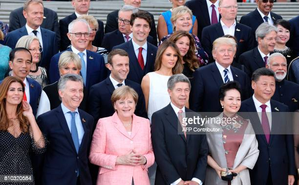 Participants of the G20 summit and their spouses pose for a family photo aroung German Chancellor Angela Merkel and her husband Joachim Sauer at the...