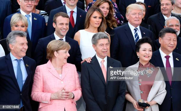 Participants of the G20 summit and their spouses pose for a family photo around German Chancellor Angela Merkel and her husband Joachim Sauer at the...
