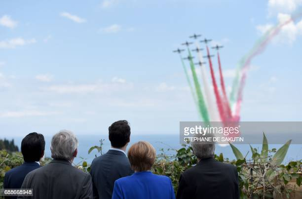 Participants of the G7 summit watch an Italian flying squadron as they attend the Summit of the Heads of State and of Government of the G7 the group...