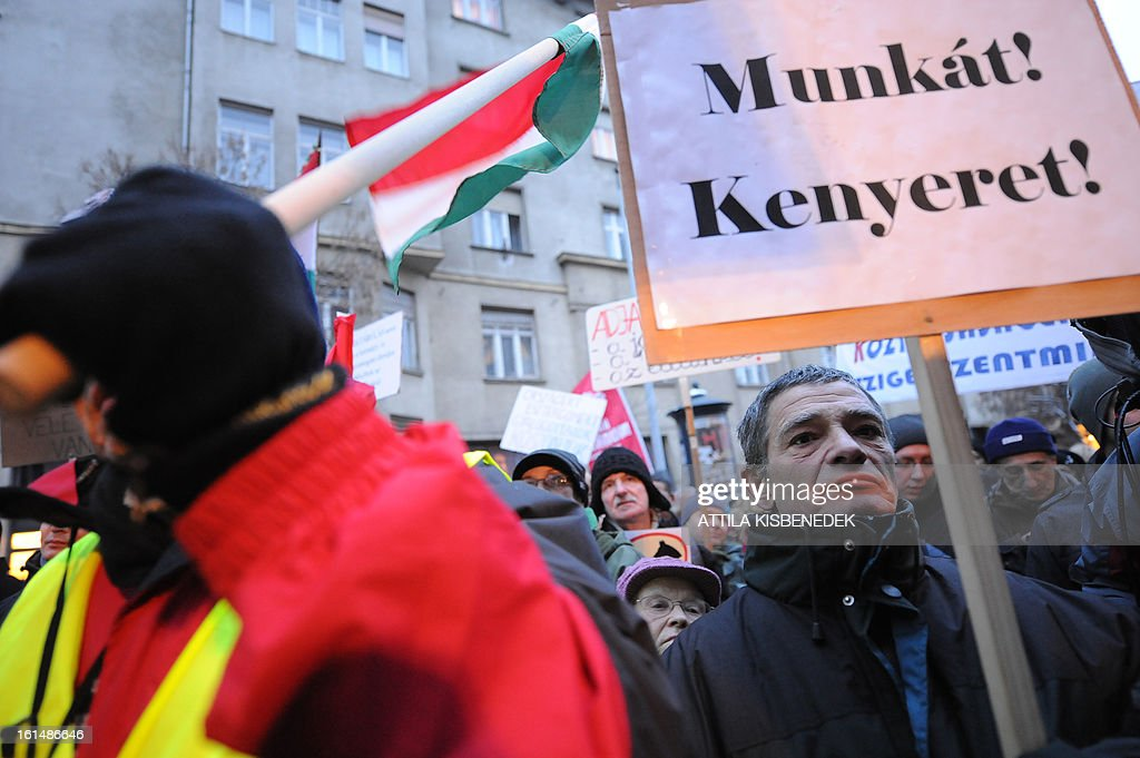 Participants of the 'Hunger march' and their sympathizers shout some anti-government slogans near the Hungarian parliament building in Budapest on February 11, 2012 during the first meeting of the Hungarian Parliament this year. Demonstrators, who arrived on foot from several Hangarian cities to protest against the Hungarian government's economy and financial policy.