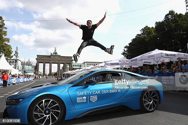 Participants of the Inline Skating BMW Berlin Marathon 2016 jump over the official safety car a BMW i8 during previews to the BMW Berlin Marathon...
