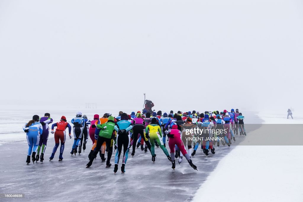 Participants of the National Championship Marathon at the Veluwemeer (Lake Veluwe) compete near Elburg, The Netherlands, on January 25, 2013. Due to cold, mist and bad ice a lot of the contestants did not make it to the finish line. AFP PHOTO/ VINCENT JANNINK netherlands out