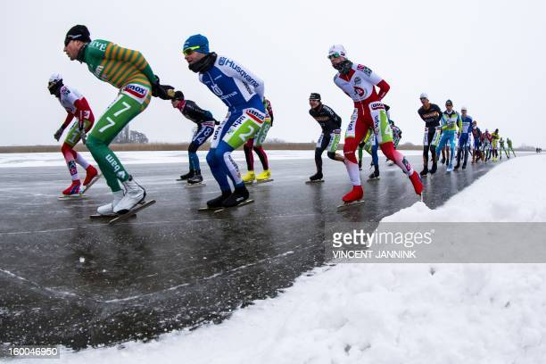 Participants of the National Championship Marathon at the Veluwemeer compete near Elburg The Netherlands on January 25 2013 Due to cold mist and bad...