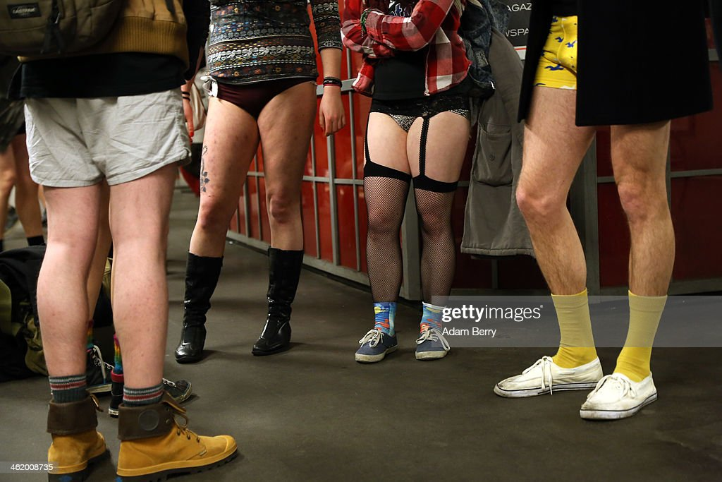 Participants of the No Pants Subway Ride wait for a train on January 12 2014 in Berlin Germany The annual event in which participants board a subway...