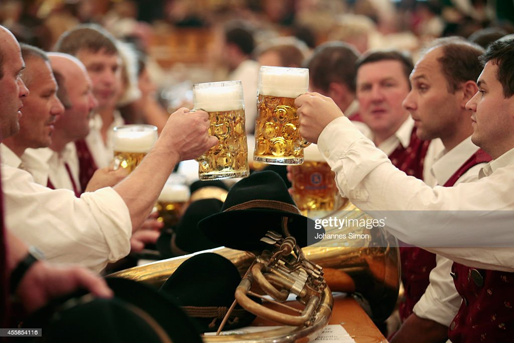 Participants of the Parade of Costumes and Riflemen enjoy drinking beer at Schuetzen beer tent on the second day of the 2014 Oktoberfest on September...