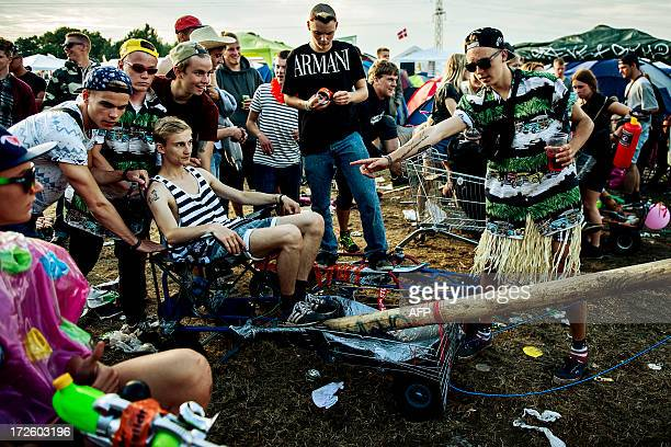 Participants of the Roskilde festival compete in a soapboxcar race on wednesday July 3 2013 Six teams had built elaborate cars and competed eagerly...