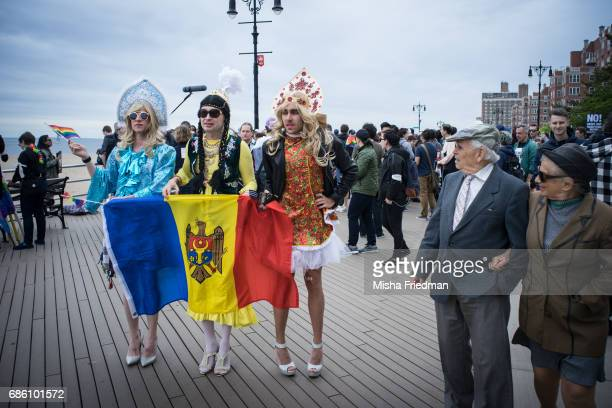 Participants of the Russianspeaking LGBT Pride March pose for photographs on Brighton Beach boardwalk on May 20 2017 in the Brooklyn borough of New...
