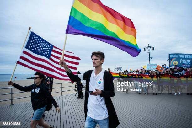 Participants of the Russianspeaking LGBT Pride March walk down Brighton Beach boardwalk on May 20 2017 in the Brooklyn borough of New York This is...