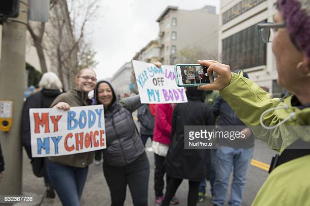 Participants of the Women's March taking pictures in San Francisco California on January 21 2017 after Donald Trump's presidential inauguration...