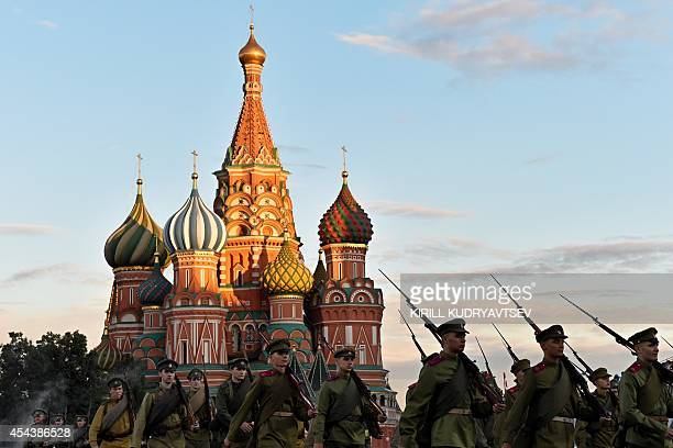 Participants perform during the Spasskaya Tower international military and music Festival on Red Square in Moscow on August 30 2014 The festival...