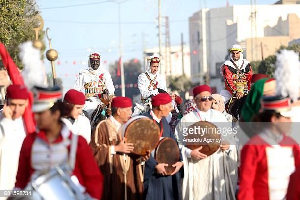 Participants perform shows during the opening of International Festival of the Sahara at AlShuhada Square in Douz Kebili Tunisia on January 13 2017...