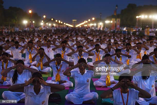 Participants perform yoga during the rehearsals for the upcoming International Yoga Day at Rajpath on June 19 2016 in New Delhi India International...