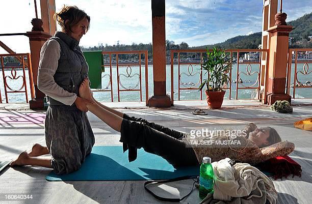 Participants perform yoga exercises during the international Yoga festival at the Parmarth Niketam Ashram in Rishikesh on March 3 2011Thirty six...